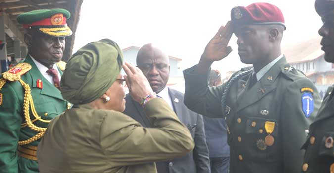 Commander-in-Chief Ellen Johnson Sirleaf salutes newly commissioned Chief of Staff of the AFL