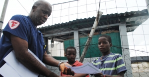 Photo Caption: A nine-year-old survivor, Moses Duo, receives certificate of being cured of Ebola